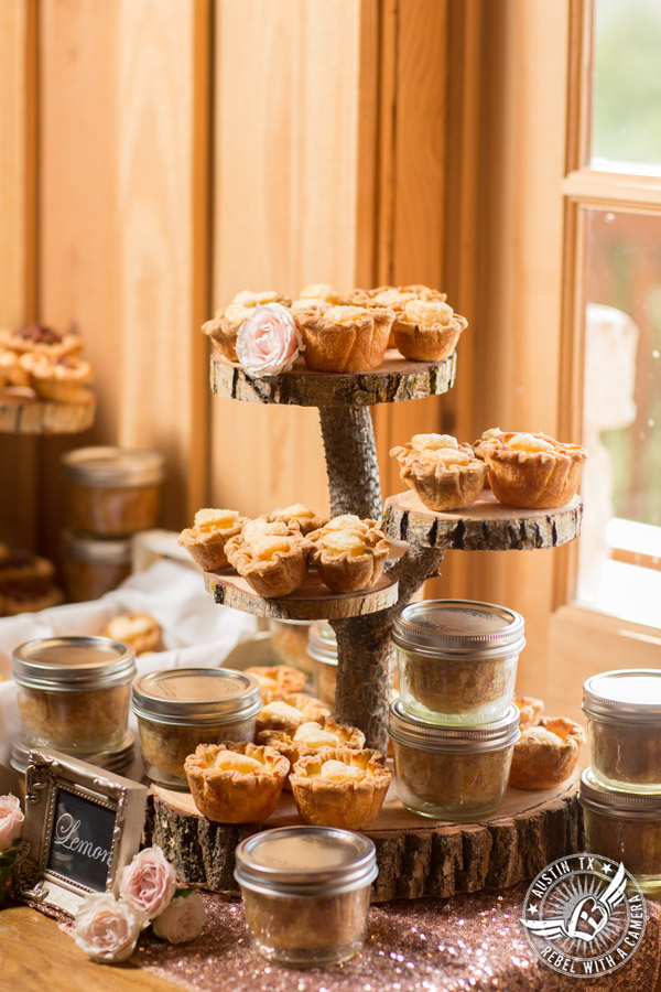 Romantic wedding pictures at The Springs Events in Georgetown, Texas - Gabriel Springs - delicious dessert display table with pies from Tiny Pies at wedding reception