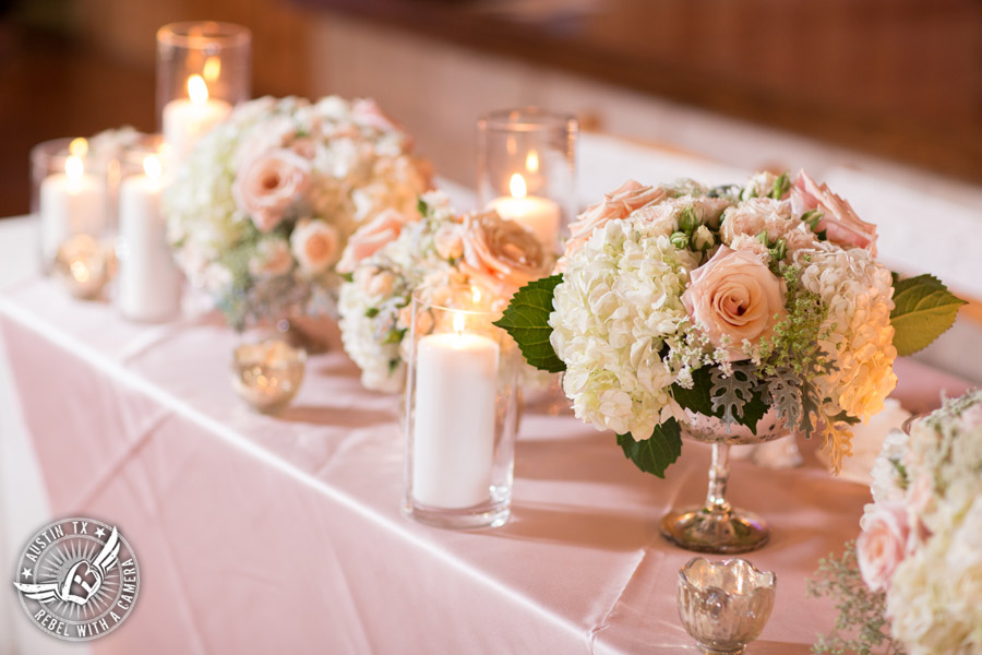 Romantic wedding pictures at The Springs Events in Georgetown, Texas - Gabriel Springs - light pink rose and white hydrangea floral centerpieces in mercury glass by Sixpence Floral Design with light pink linens and white candles