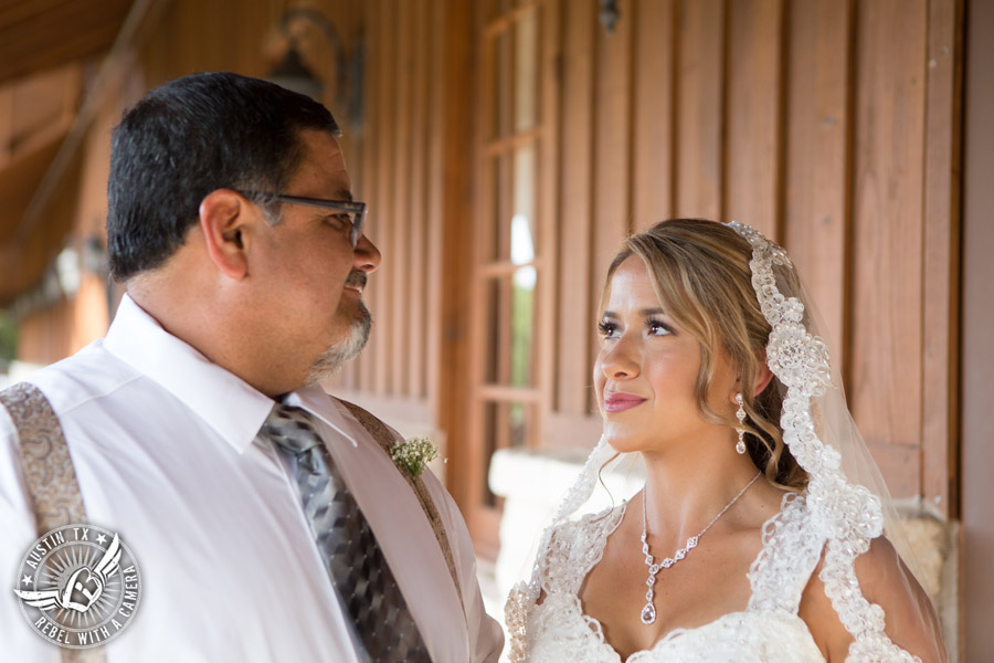 Romantic wedding pictures at The Springs Events in Georgetown, Texas - Gabriel Springs - bride looks at father before he escorts her down the aisle to the wedding ceremony