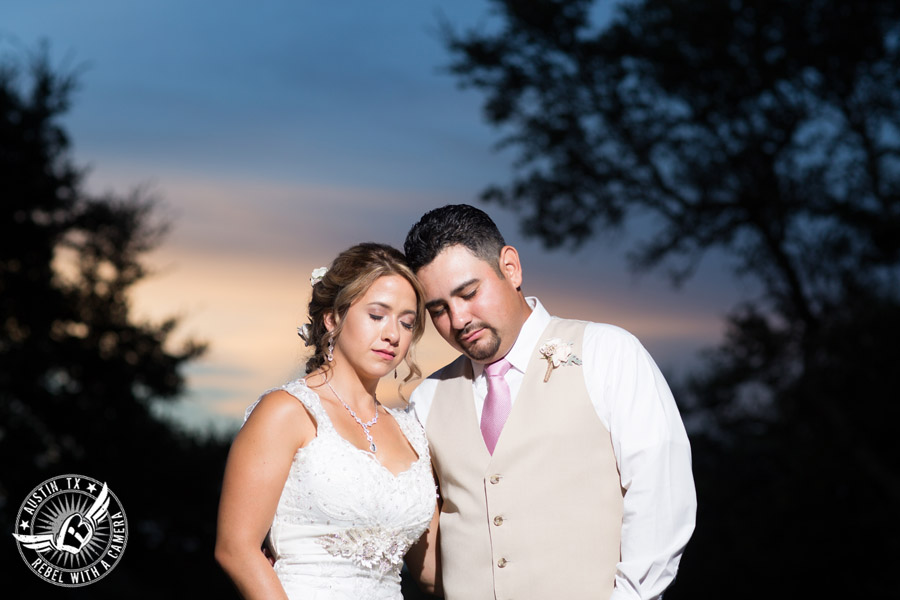 Romantic wedding pictures at The Springs Events in Georgetown, Texas - Gabriel Springs - soft moment between bride and groom