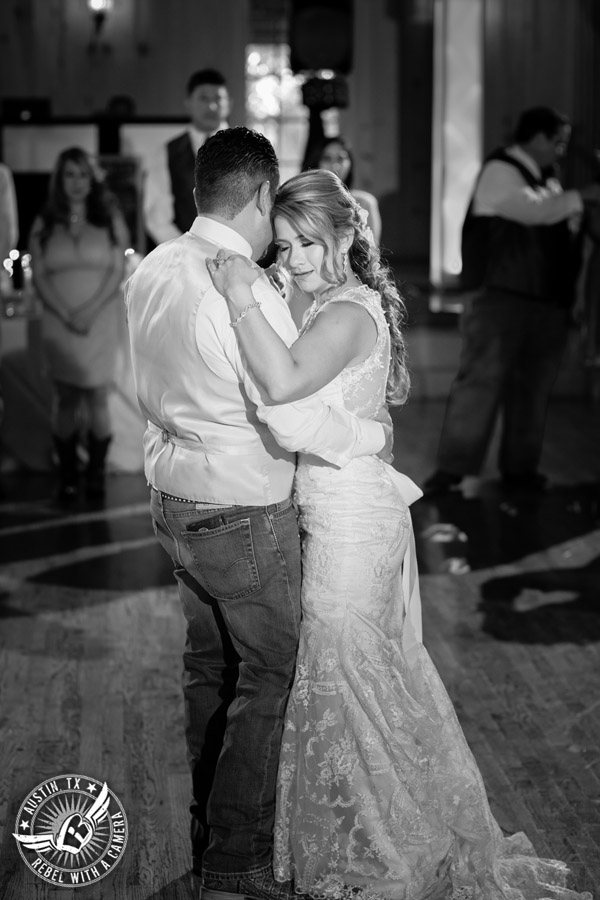 Romantic wedding pictures at The Springs Events in Georgetown, Texas - Gabriel Springs - bride and groom dance their first dance during the wedding reception with Made from Scratch Weddings DJ