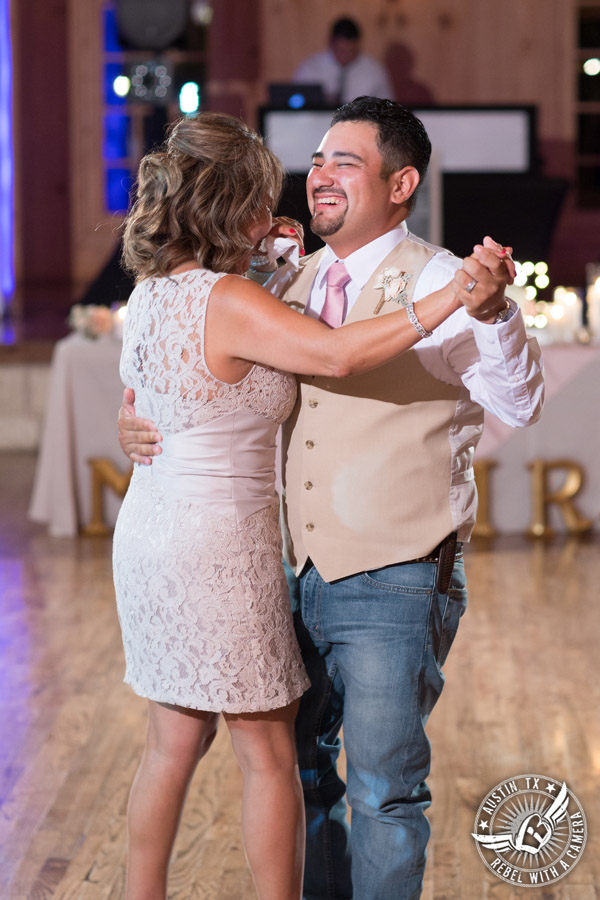 Romantic wedding pictures at The Springs Events in Georgetown, Texas - Gabriel Springs - groom and and his mother dance during the wedding reception with Made from Scratch Weddings DJ