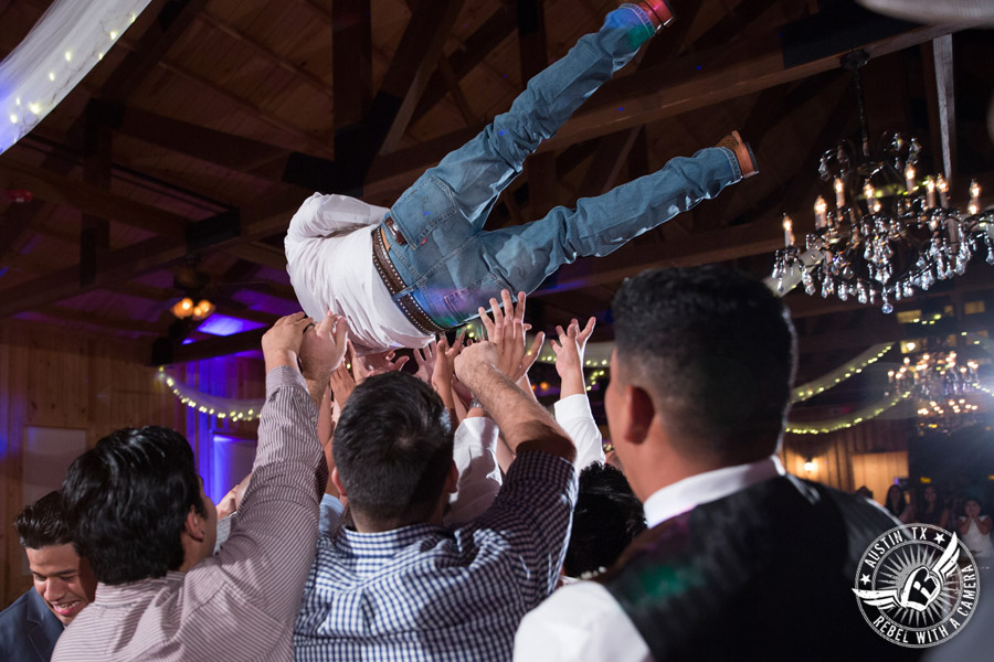 Romantic wedding pictures at The Springs Events in Georgetown, Texas - Gabriel Springs - guests dance during the wedding reception with Made from Scratch Weddings DJ