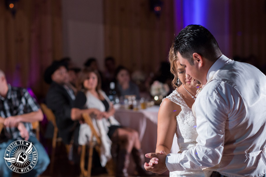 Romantic wedding pictures at The Springs Events in Georgetown, Texas - Gabriel Springs - bride and groom dance their last dance during the wedding reception with Made from Scratch Weddings DJ