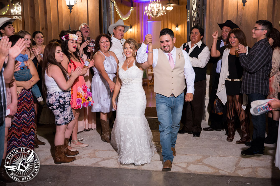 Romantic wedding pictures at The Springs Events in Georgetown, Texas - Gabriel Springs - bride and groom exit the wedding reception