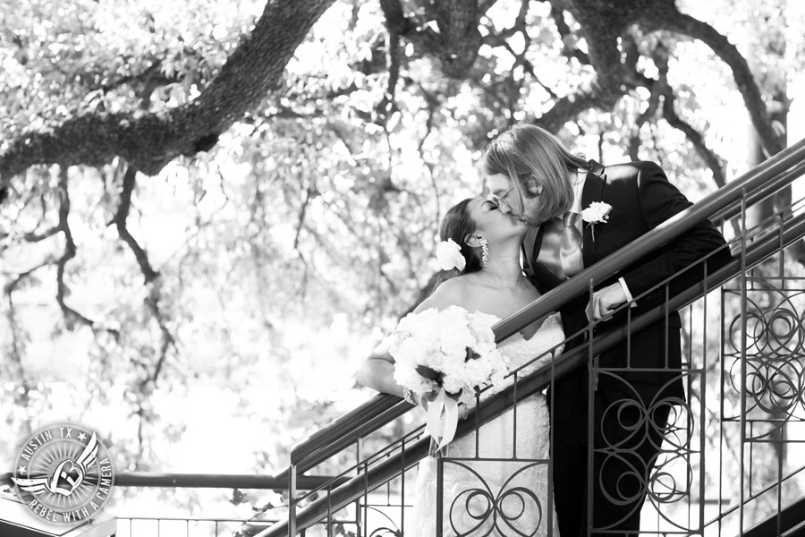 Austin wedding photographer at Olive and June - bride and groom kiss on stairs