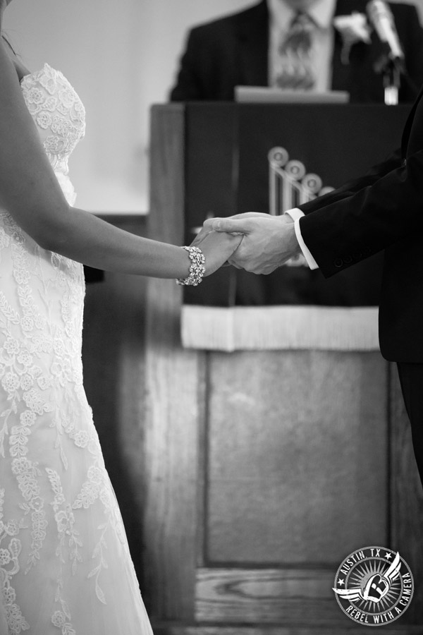 Austin wedding photographer at Hyde Park Presbyterian - bride and groom hold hands at wedding ceremony
