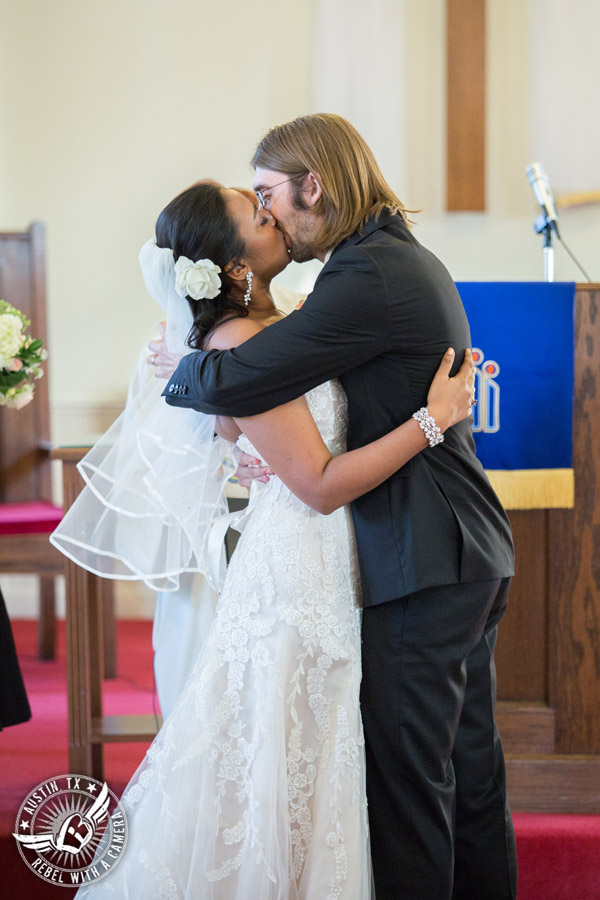 Austin wedding photographer at Hyde Park Presbyterian - bride and groom kiss at wedding ceremony