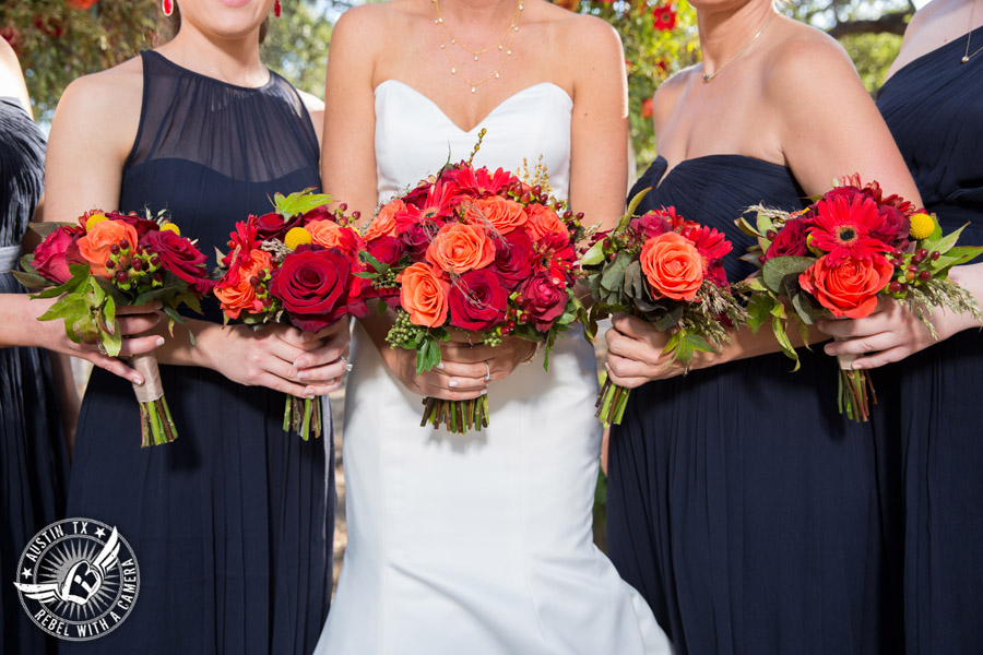 Hamilton Twelve wedding photos - bride and bridesmaids in navy dresses and red and orange bouquets by the Flower Girl