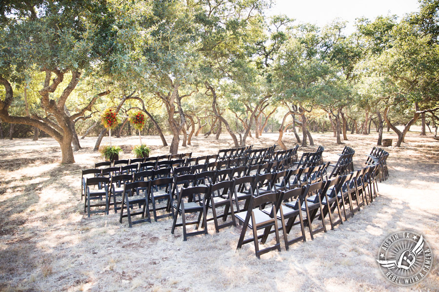 Hamilton Twelve wedding photos - ceremony site dark wood chairS and arbor by the Flower Girl
