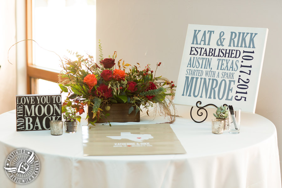 Hamilton Twelve wedding photos - sign in table and floral centerpiece by the Flower Girl with red and orange roses