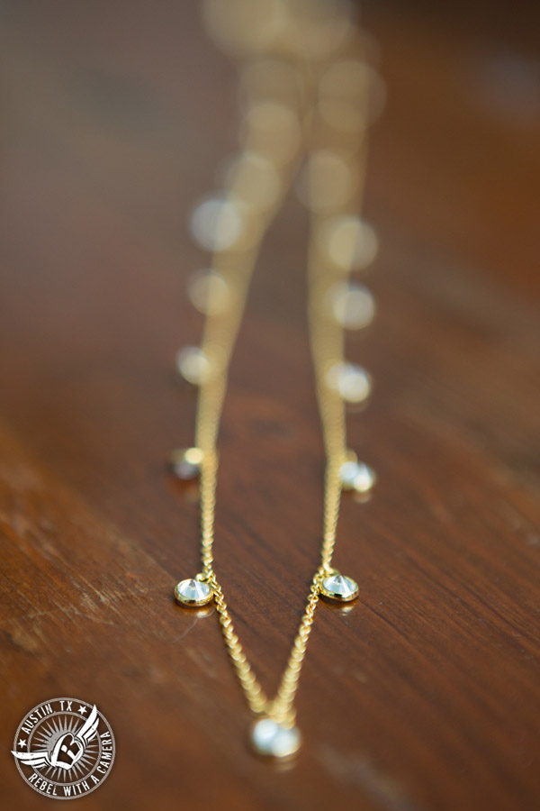 Hamilton Twelve wedding photos - gold and rhinestone necklace in the bride's room
