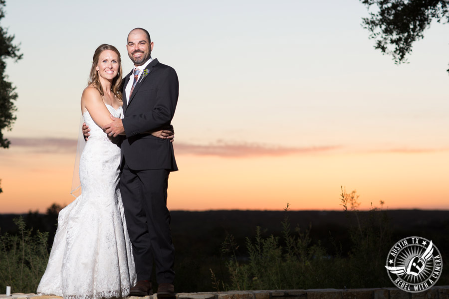 Wedding pictures at Thurman's Mansion at the Salt Lick - bride and groom with the sunset