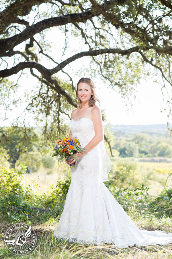 Wedding pictures at Thurman's Mansion at the Salt Lick - bride under the oak trees