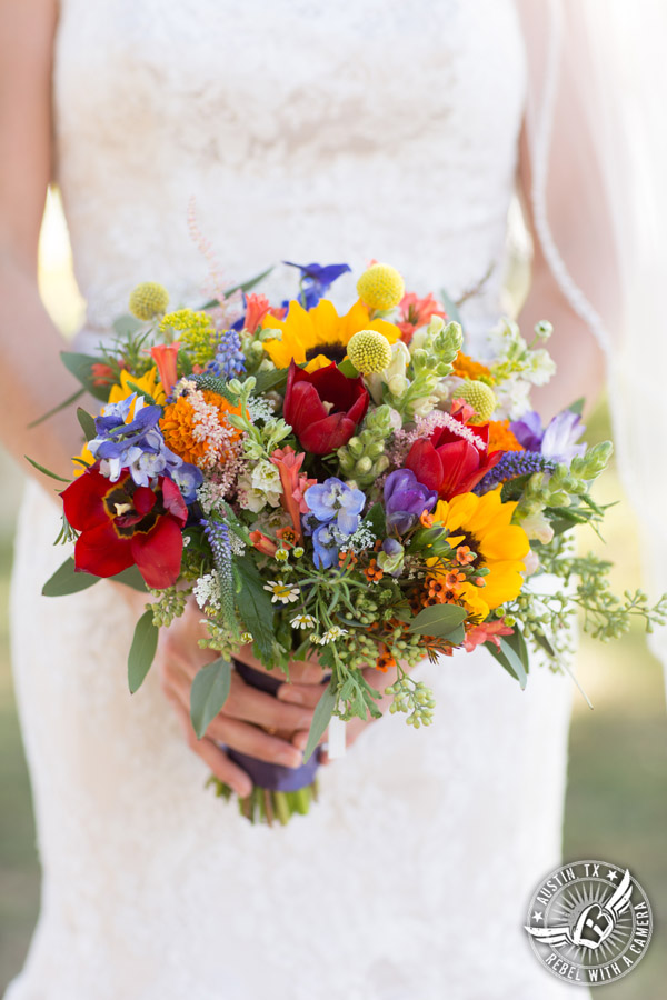 Wedding pictures at Thurman's Mansion at the Salt Lick - colorful wildflower bridal bouquet by Verbena Floral Design