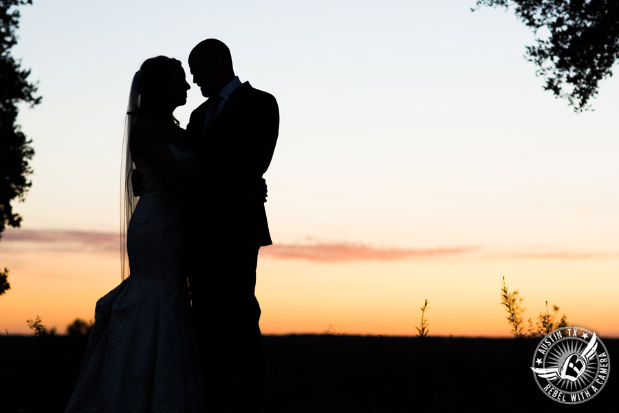 Wedding pictures at Thurman's Mansion at the Salt Lick - silhouette of bride and groom with the sunset