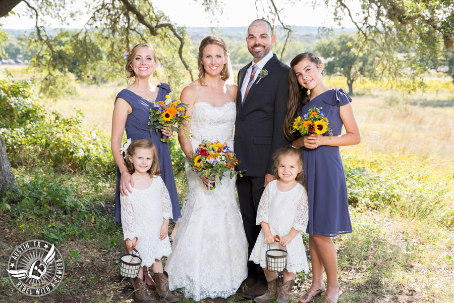 Wedding pictures at Thurman's Mansion at the Salt Lick - wedding party under the oak trees - florals by Verbena Floral Design