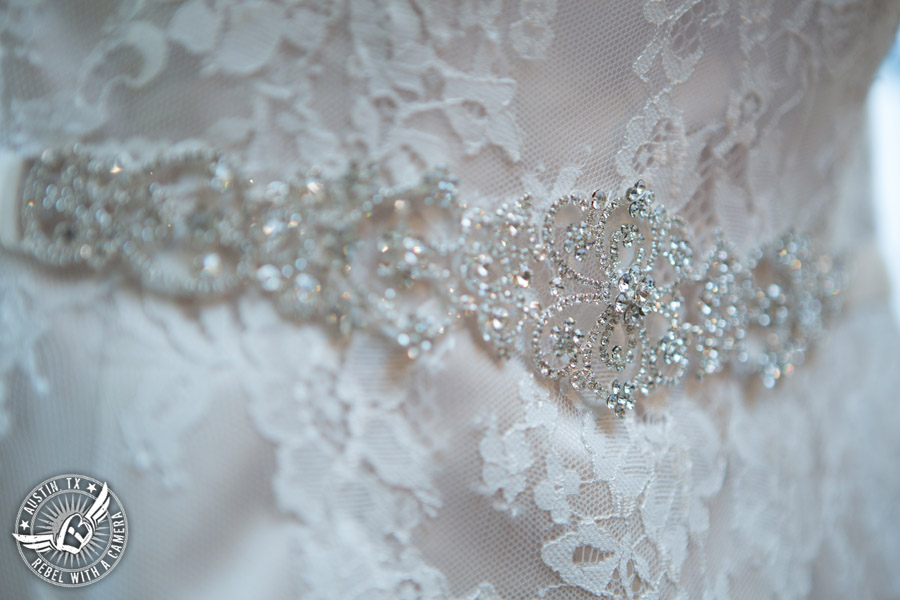 Wedding pictures at Thurman's Mansion at the Salt Lick - rhinestone detail on lace bridal gown