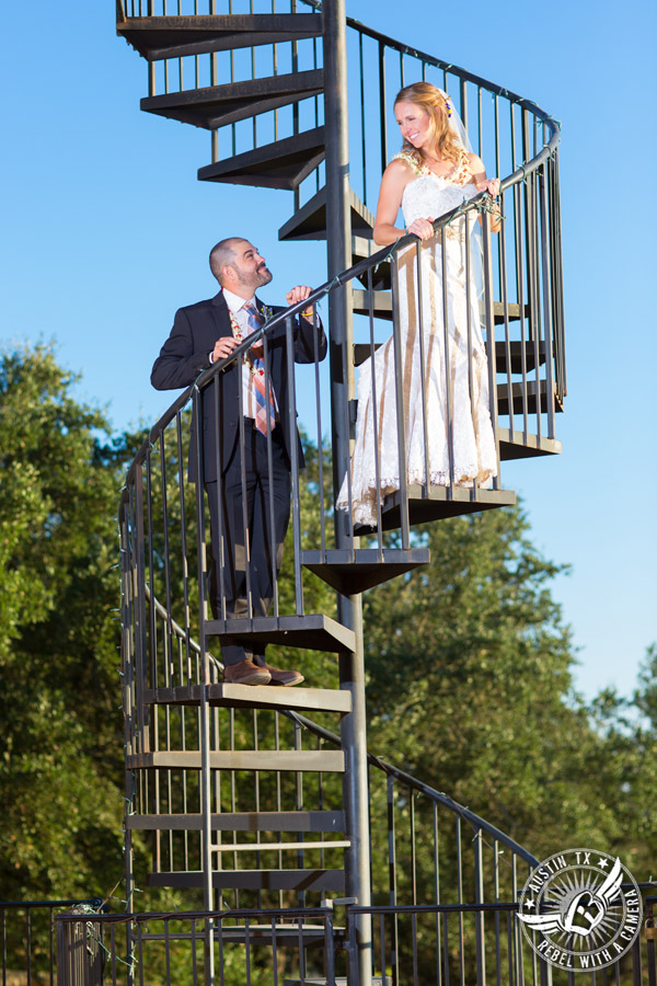 Wedding pictures at Thurman's Mansion at the Salt Lick - bride and groom on spiral staircase