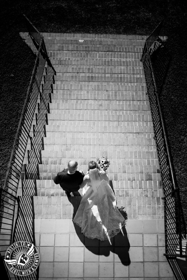 Wedding pictures at Thurman's Mansion at the Salt Lick - bride and father walk down the steps to the wedding ceremony