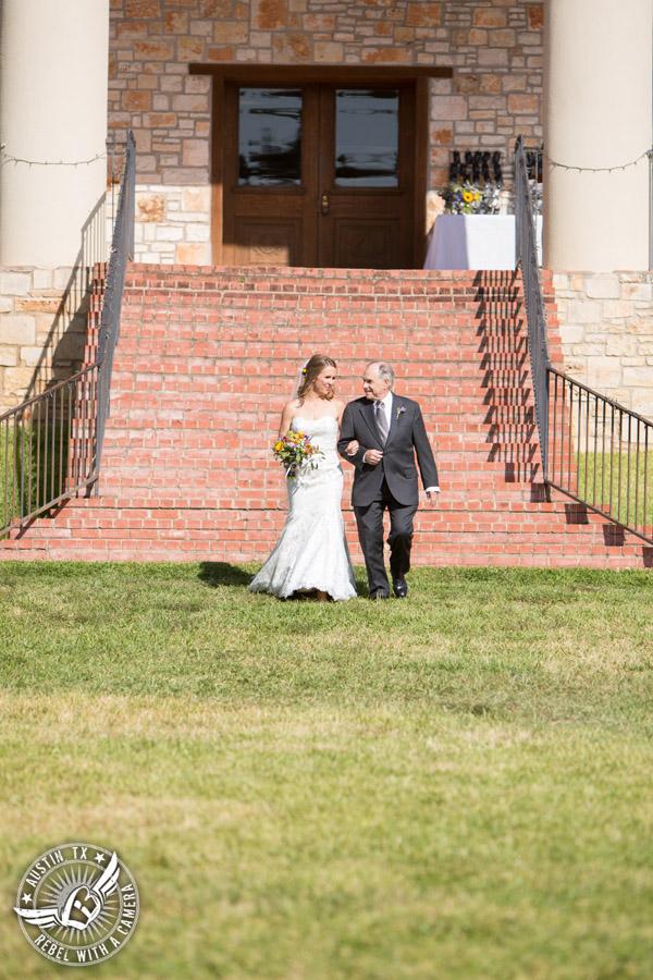 Wedding pictures at Thurman's Mansion at the Salt Lick - bride and father walk down to the wedding ceremony