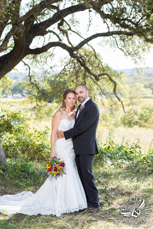 Wedding pictures at Thurman's Mansion at the Salt Lick - bride and groom under the oak trees