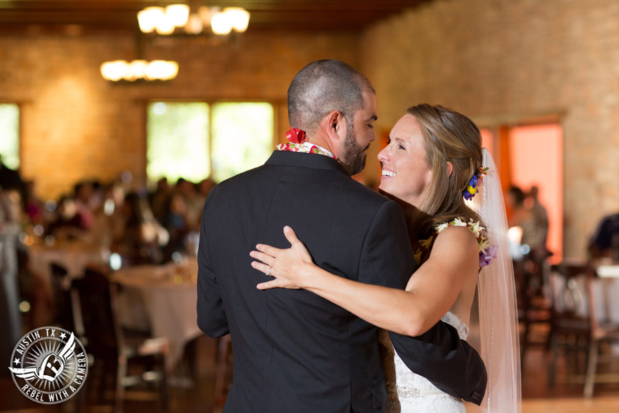 Wedding pictures at Thurman's Mansion at the Salt Lick - bride and groom dance their first dance at the wedding reception - Live Oak DJ