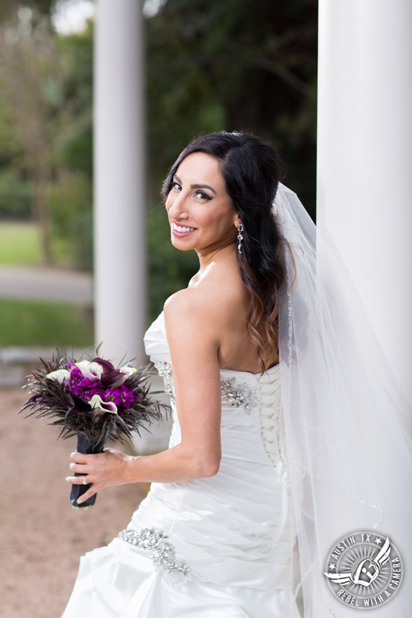 Dramatic bridal portraits at Laguna Gloria the Contemporary Austin with purple calla lily bouquet by Statue of Design.