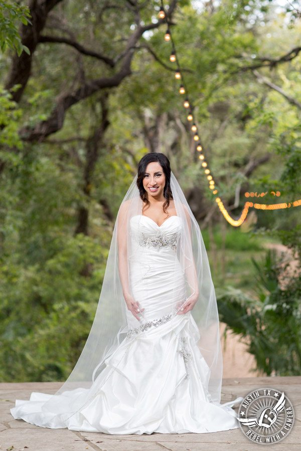 Dramatic bridal portraits at Laguna Gloria the Contemporary Austin with bridal hair styling by Sirens Salon.