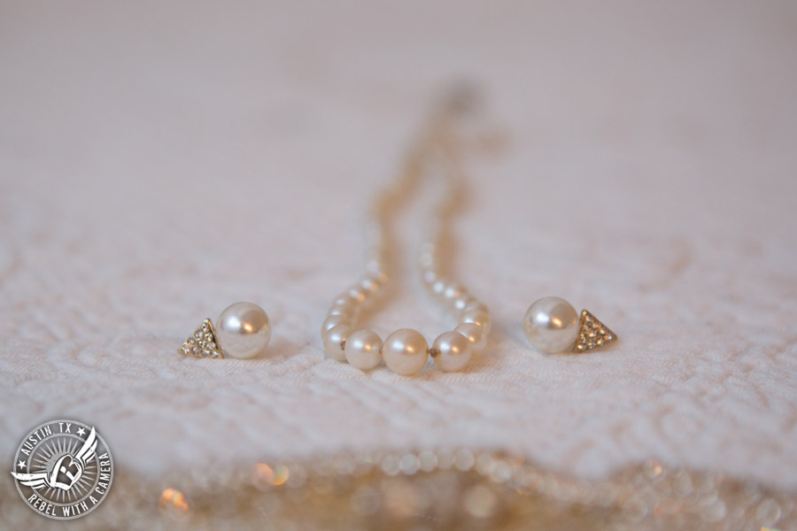 Wedding picture of the bride's pearl jewelry in the bride's room at the Texas Federation of Women's Clubs Headquarters in Austin, Texas