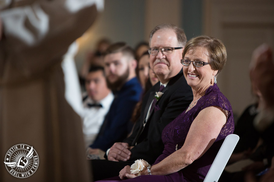 Wedding picture of the groom's parents at the wedding ceremony in the ballroom at the Texas Federation of Women's Clubs Headquarters in Austin, Texas