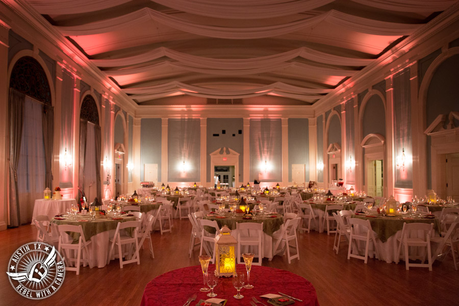 Wedding picture of the reception with uplighting and centerpieces from VasesVases in the ballroom at the Texas Federation of Women's Clubs Headquarters in Austin, Texas