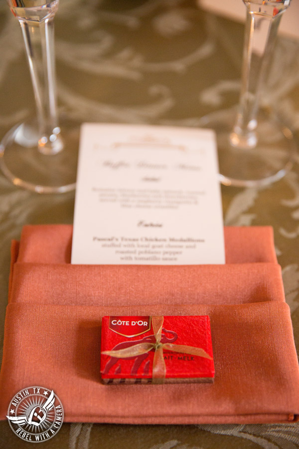 Wedding picture of the place setting with Belgian chocolate wedding favor and menu from Pascal's Catering Company in the ballroom at the Texas Federation of Women's Clubs Headquarters in Austin, Texas