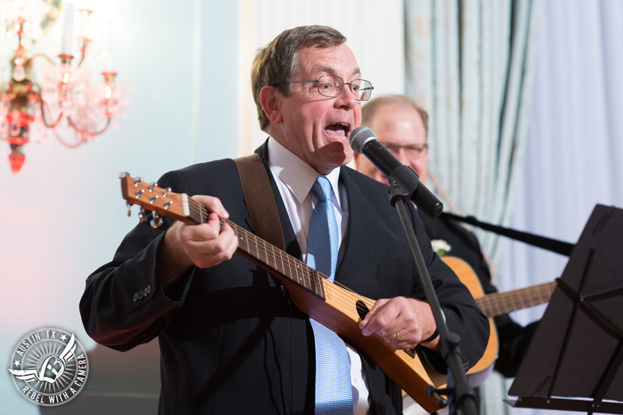 Wedding picture of musical performance during the speeches at the reception in the ballroom at the Texas Federation of Women's Clubs Headquarters in Austin, Texas