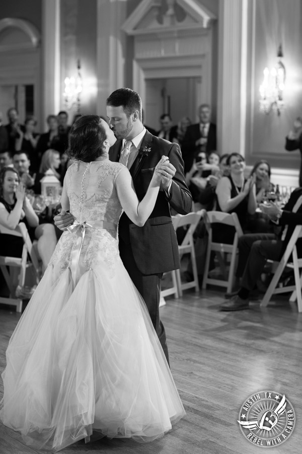 Wedding picture of bride and groom's first dance with Byrne Rock DJ at the reception in the ballroom at the Texas Federation of Women's Clubs Headquarters in Austin, Texas