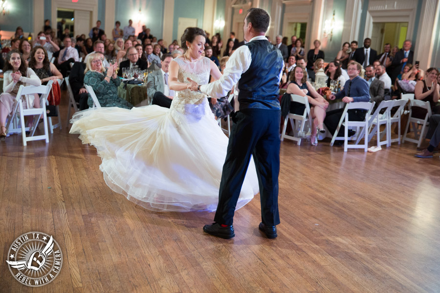 Wedding picture of bride dancing with father with Byrne Rock DJ at the reception in the ballroom at the Texas Federation of Women's Clubs Headquarters in Austin, Texas