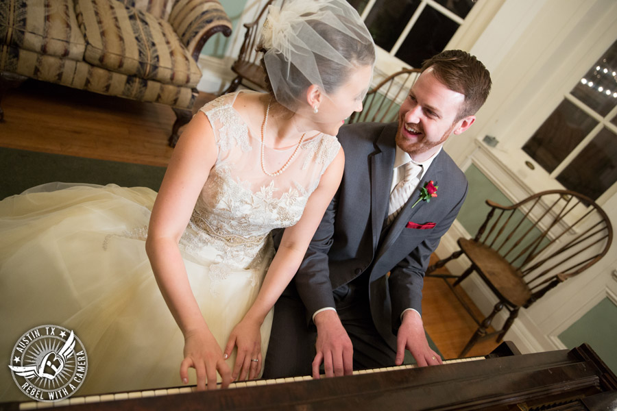 Wedding picture of groom playing piano for bride at the Texas Federation of Women's Clubs Headquarters in Austin, Texas.