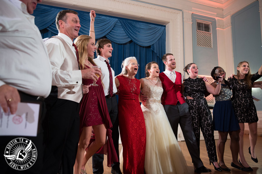 Wedding picture of dancing with Byrne Rock DJ at the reception in the ballroom at the Texas Federation of Women's Clubs Headquarters in Austin, Texas