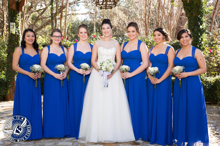 Beautiful wedding pictures on Lake Travis - bride in Maggie Sottero wedding gown with bridesmaids - hair and makeup from lola beauty