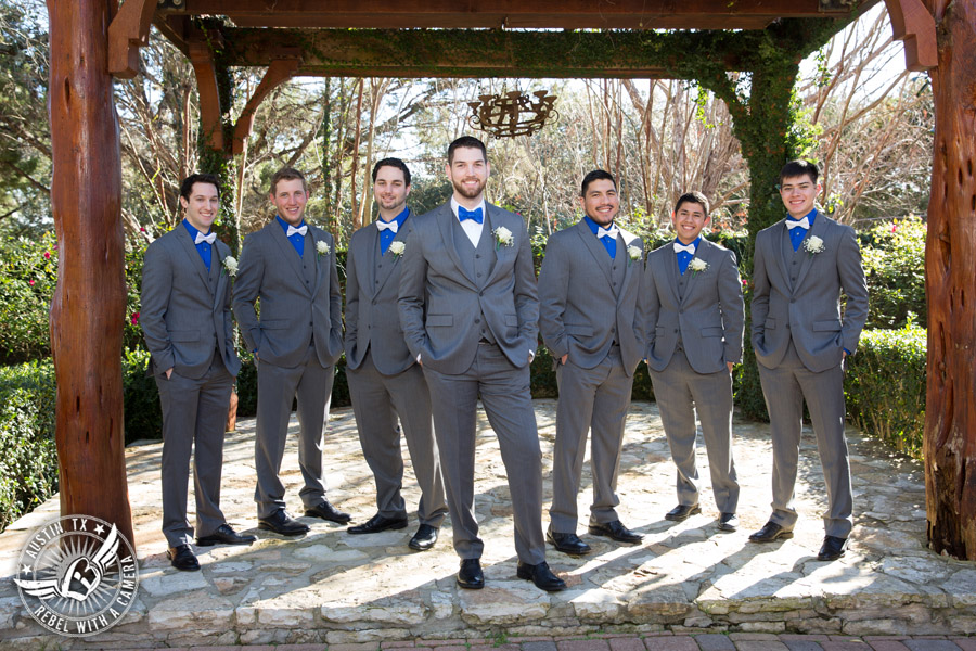 Beautiful wedding pictures on Lake Travis - groom in blue bow tie with groomsmen in grey suits