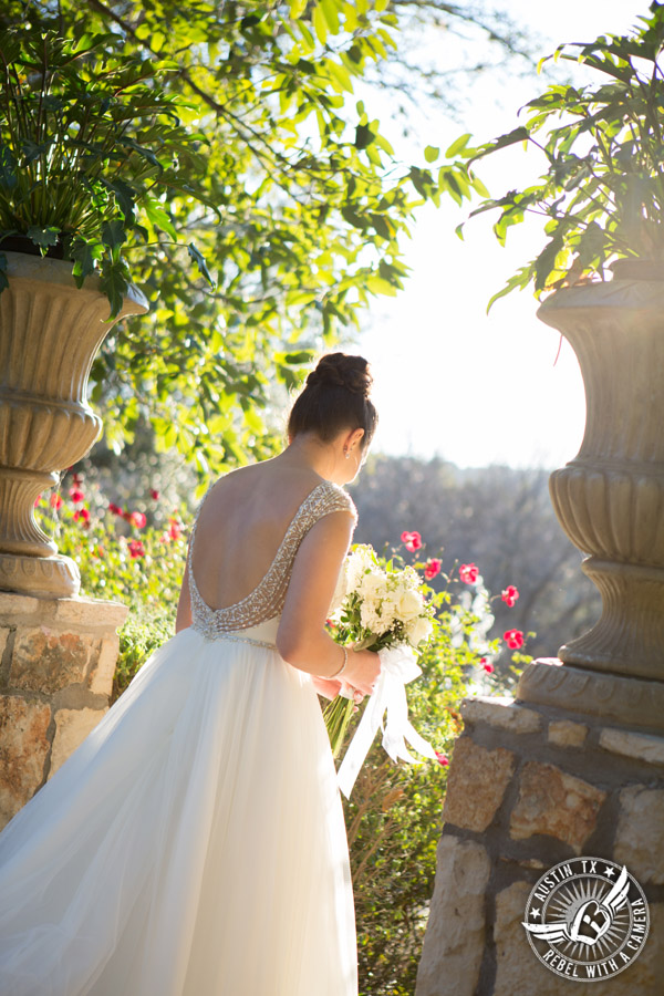 Beautiful wedding pictures on Lake Travis - bride in Maggie Sottero wedding gown walks down the aisle at the wedding ceremony