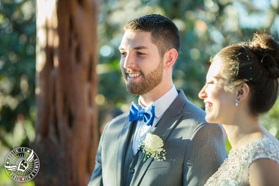 Beautiful wedding pictures on Lake Travis - bride and groom say their vows at the wedding ceremony at the arbor