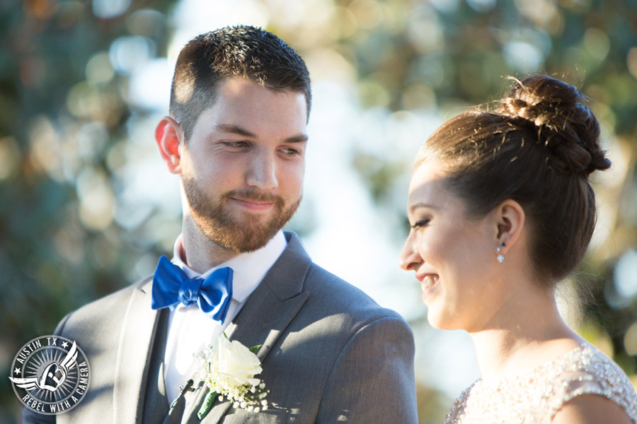 Beautiful wedding pictures on Lake Travis - bride and groom say their vows during the wedding ceremony at the arbor