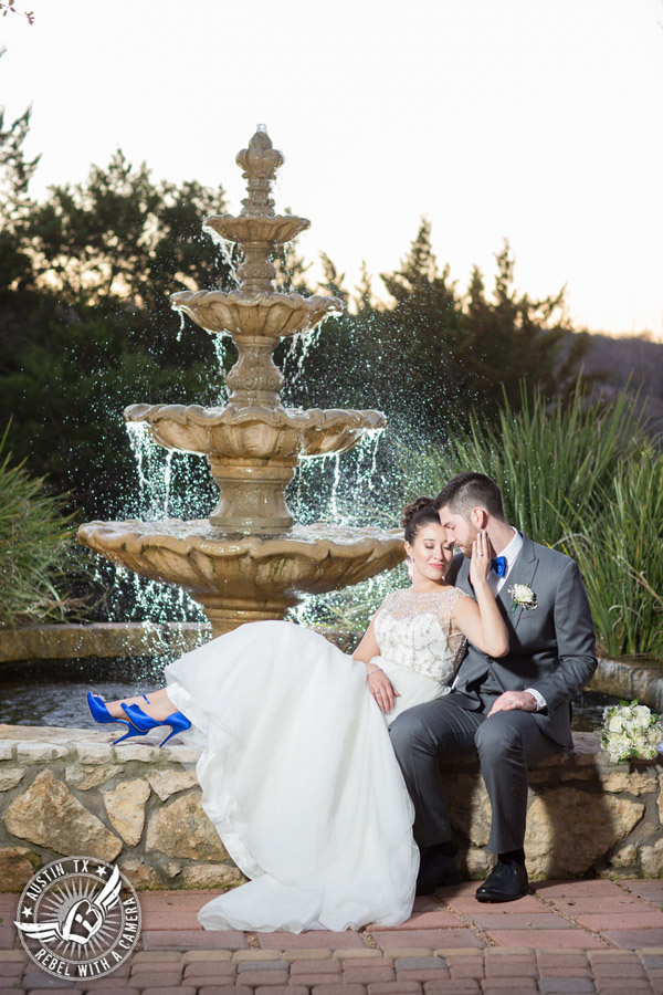 Beautiful wedding pictures on Lake Travis - bride in Maggie Sottero wedding gown with groom in front of fountain