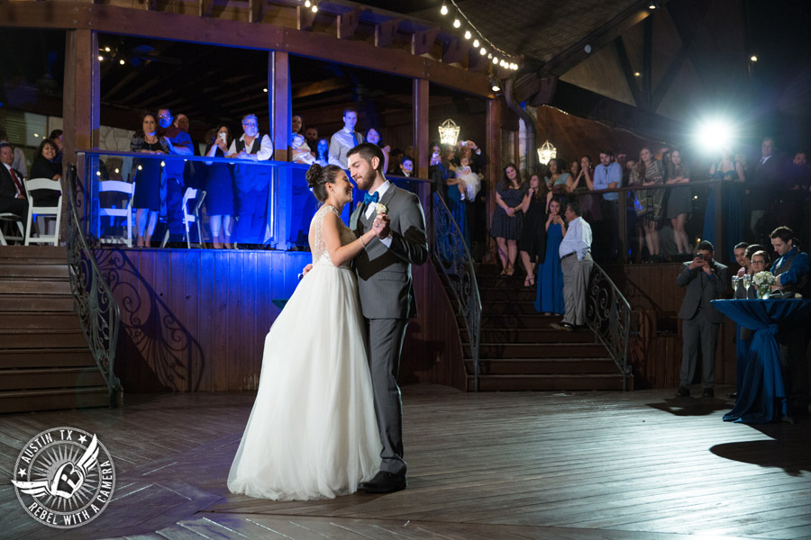 Beautiful wedding pictures on Lake Travis - bride and groom dance their first dance on the deck with Greenbelt DJ