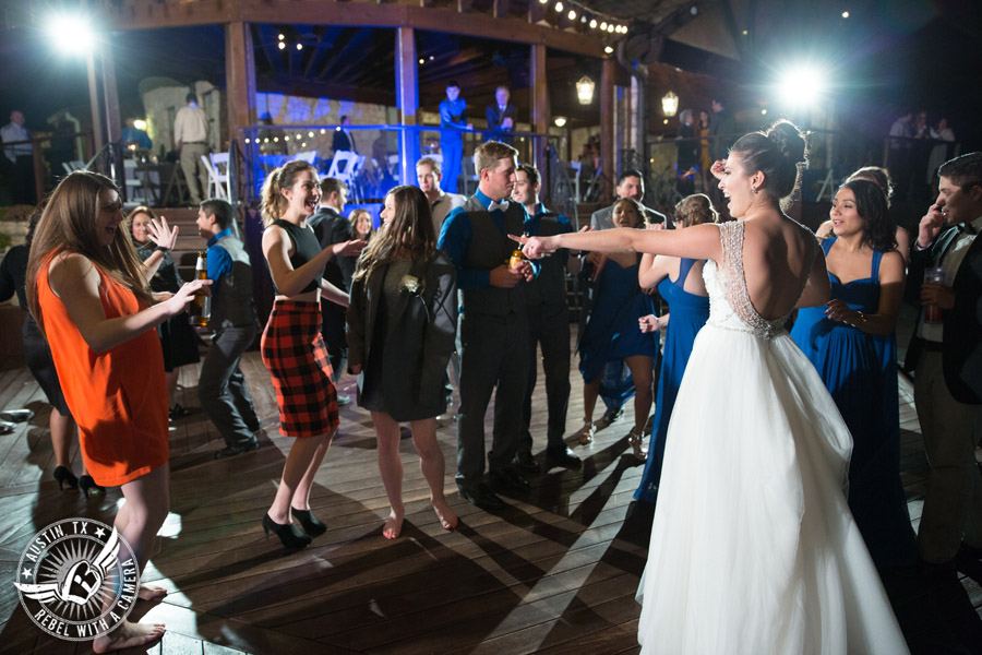 Beautiful wedding pictures on Lake Travis - guests dance on the deck with Greenbelt DJ