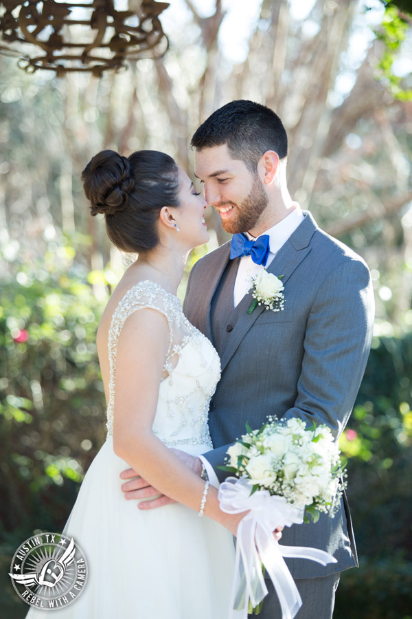 Beautiful wedding pictures on Lake Travis - bride in Maggie Sottero wedding gown with groom in blue bow tie