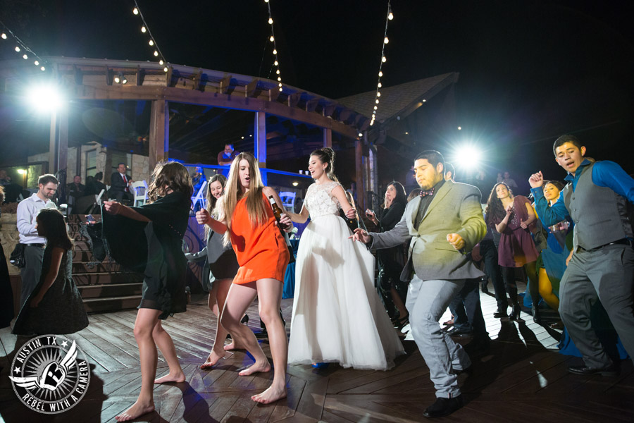 Beautiful wedding pictures on Lake Travis - wedding guests dance on the deck with Greenbelt DJ