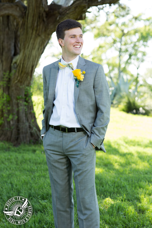 Fun Wedding Pictures at TerrAdorna in Austin, Texas - groom with yellow bowtie and boutonniere and grey suit