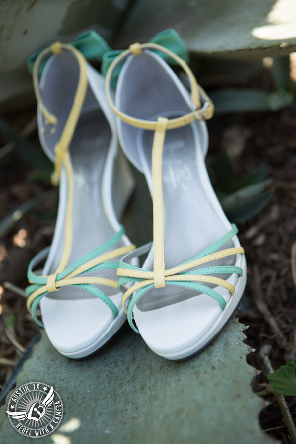 Fun Wedding Pictures at TerrAdorna in Austin, Texas - bride's shoes with green leather bow